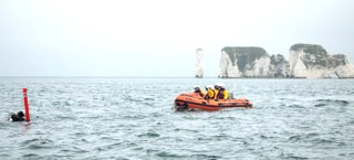 RNLI boat and diver with SMB up