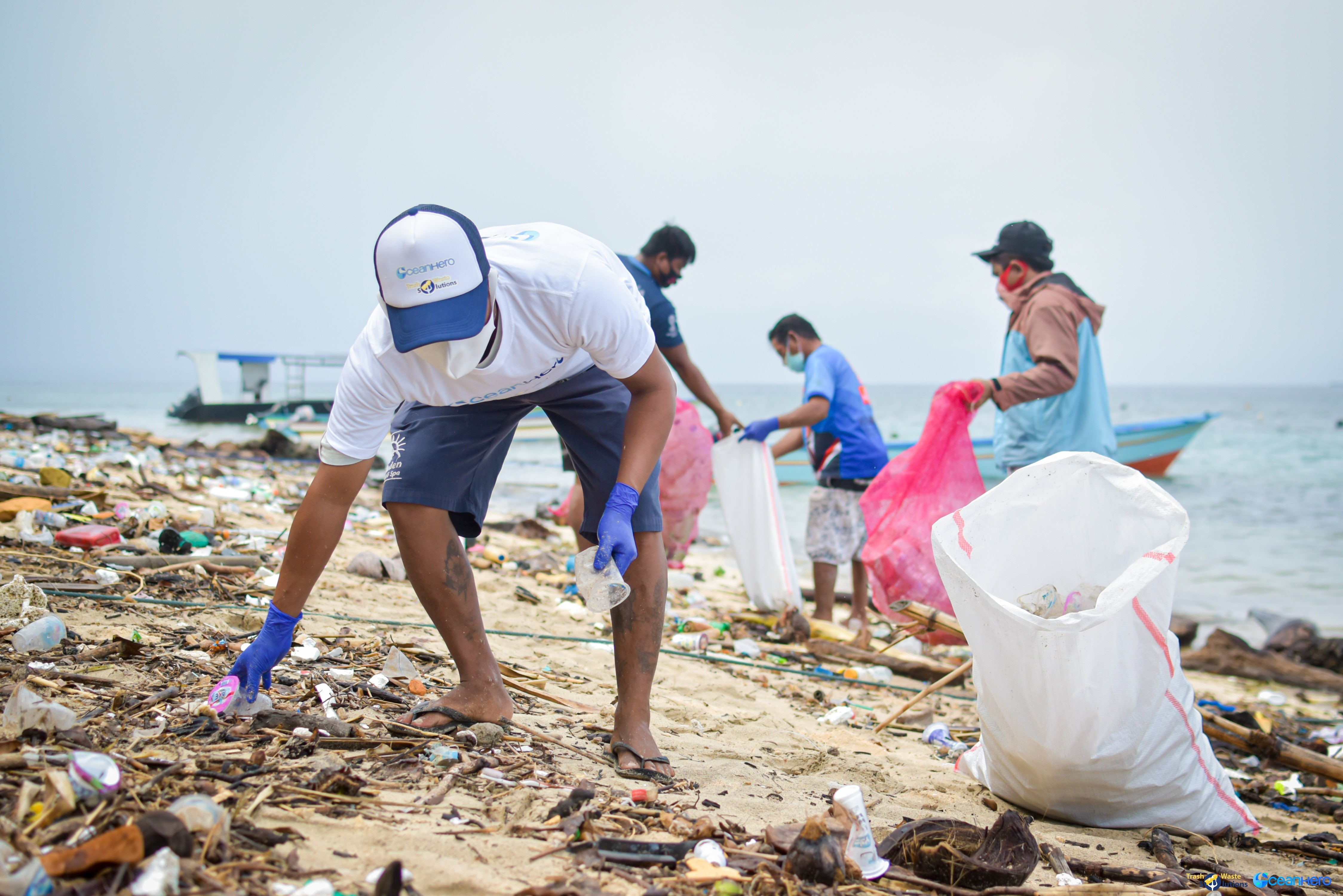 Trash Waste Solution member is part of the beach clean-up